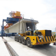 Beam transporting vehicle for launcher grider crane